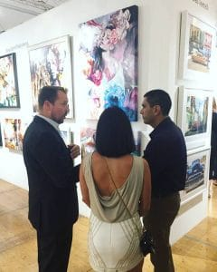 GM Justin Montgomery meeting with fine art collectors.